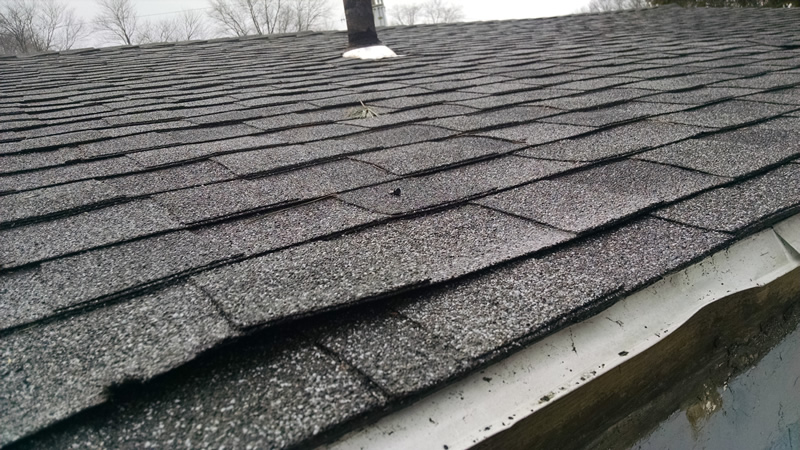 Ice dams can cause your shingles to lift and to wear. Water will penetrate up through your shingles and cause water to get into your home. Here, a driving rain will penetrate this roof